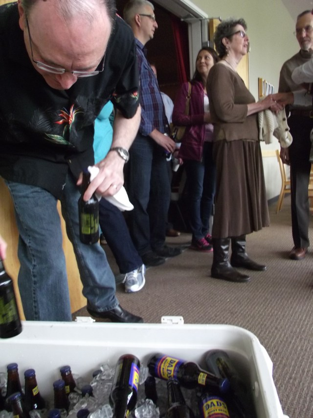 A volunteer restocks a cooler full of Dad's Root Beer as attenders of the Calvary Fellowship 9:30 a.m. service file out of the sanctuary on Sunday. The Mountlake Terrace church has been giving away the sodas to dads on Fathers' Day for more than 20 years, even before the church moved to the city from its Wallingford district location in Seattle. (Photos by Doug Petrowski)