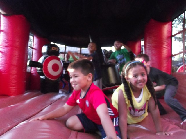 Kids enjoy the inflatable bouncy house.