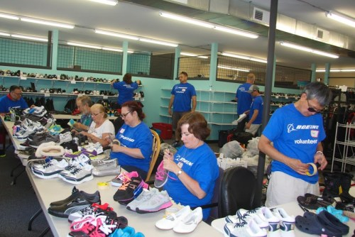Boeing employees and retired Sno-King Bluebills volunteered at Clothes For Kids on July 12.