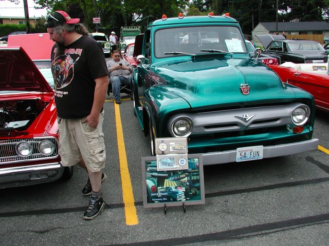 Despite the drizzle, hundreds showed up to view the classic cars, listen to blues music and eat barbecue.