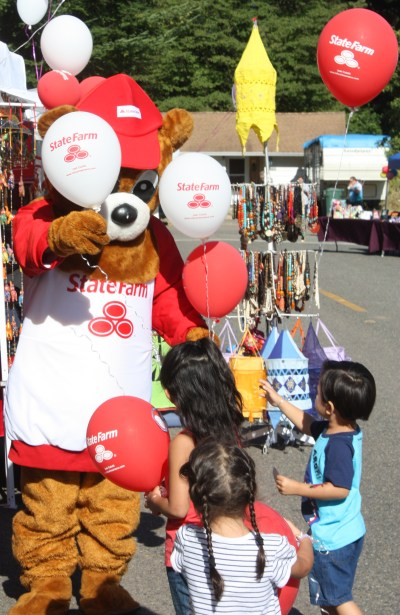 The State Farm Bear gave away balloons.