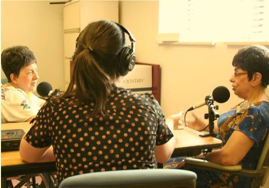 A Story Corps interview recording session.