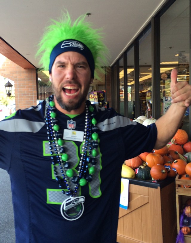 Brad, who works at the MLT QFC, shows his Hawks pride. (Photo by David Carlos)
