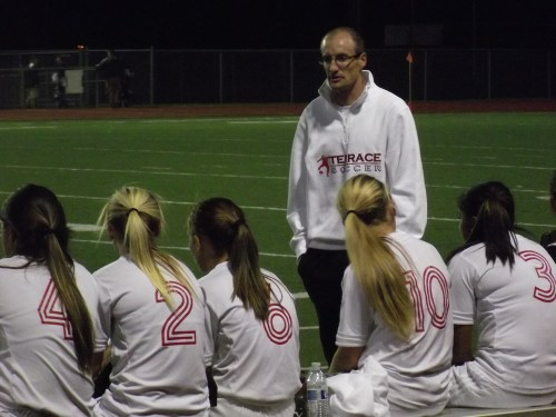 Coach Evan Hatch talks strategy with his Hawk soccer team during halftime of their match against Inglemoor at Edmonds District Stadium.