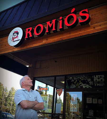 Owner Howard Goehring looks at the new Romio's sign.  Goehring acquired the former site of Prime Pizza last July, when he moved from his former site near the county line on 56th Ave W.  The sign was installed just last Friday, 9/12/14.