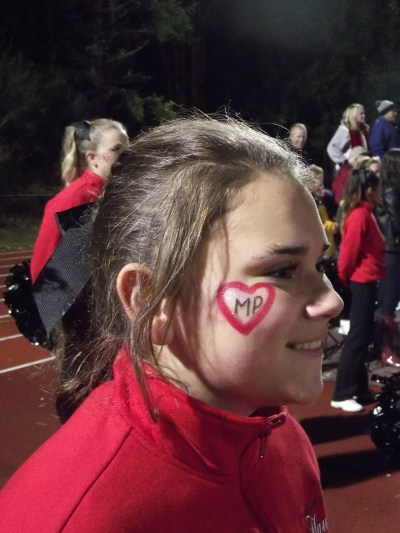 Members of the Mountlake Terrace cheer squad, including sophomore Meeka Diaz, were sporting face paint Friday night in honor of Marysville-Pilchuck High School. (Photos by Doug Petrowski)