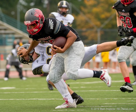 Mountlake Terrace's Sammy Abraham stiff-arms a Lynnwood defender during Friday's homecoming game at Edmonds Stadium. (Photo by Mark Hopkins)