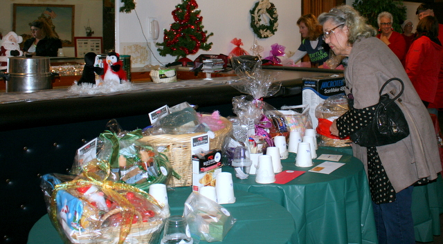 People check out the numerous gift baskets up for raffle Sunday morning at the American Legion Hall.