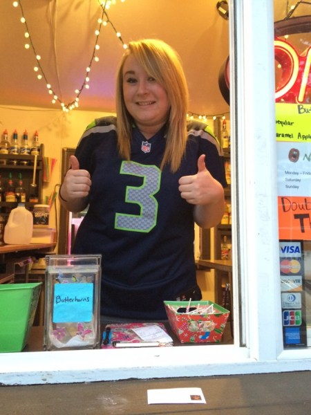 Clarissa at the Bean Feen coffee stand on 56th Ave W and 236th St SW in Mountlake Terrace gives a thumbs up to the Seattle Seahawks as they play against the Carolina Panthers today at 5:15 pm.