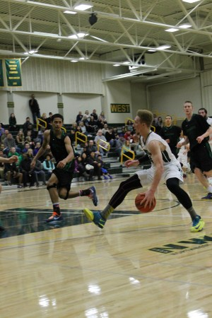 Photo #1: Former MTHS Hawk Marquis Armstead (right) tries to dribble past Hawk alum and former teammate Blake Fernandez in the Edmonds CC vs. Shoreline CC matchup Saturday night at Shoreline Community College.