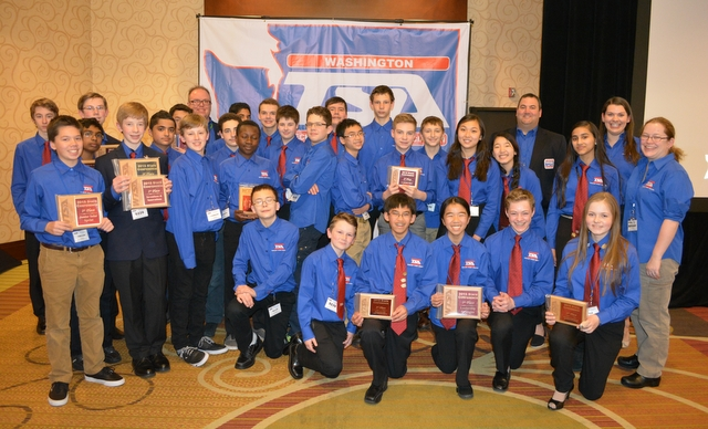 Photo #2: BTMS students show off the hardware they won during engineering, technology and leadership competitions held at the 2015 state conference.