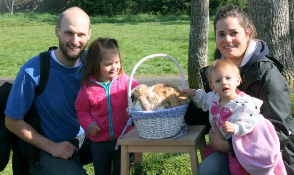Tim Fisher, his daughter Sofia, 2, his daughter Karina and wife Eloisa, 10 months,  (right) take a family photo with a rabbit.