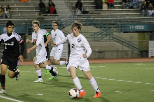 Warrior Jeremy Langsted dribbles away from Hawk Gavin Scott (far left) in the second half.