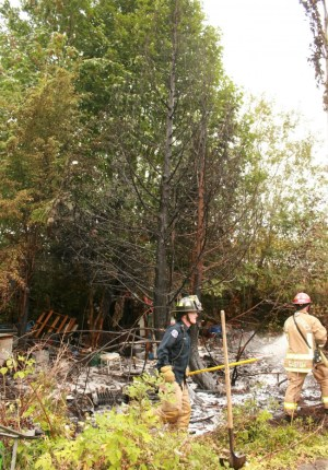 Trees, brush and items from the homeless camp were on fire.