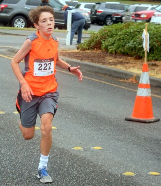 Connor Bryan, 12 of Edmonds, finishes strong.