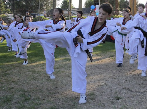 A martial arts demonstration by students from Seattle Tae Kwon Do.