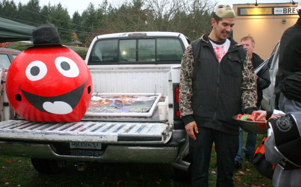 Daniel Martinez handed out candy at Red Onion Burgers trunk.