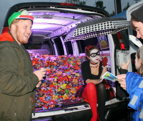 Calvary Fellowship's Corbin Anderson and Alley Tews (right) don't appear to be in any danger of running out of candy during Mountlake Terrace's annual Trunk r Treat event Saturday. Despite the occasional raindrops and wind parents and children lined up to the street to trick or treat in downtown Mountlake Terrace. (Photos by David Pan)