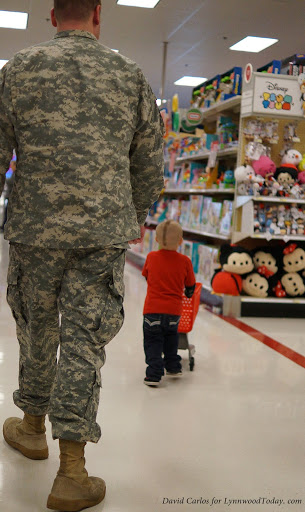 First responders escort children as they shop.