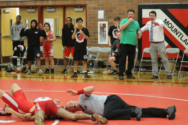 he Mountlake Terrace Hawks coaches and bench watch as the referee prepares to signal a pinfall win for Hawk Mujtaba Abosabaa Tuesday night. Abosabaa's victory gave Terrace a 42-36 win over Marysville-Pilchuck in the nightcap of a double dual at Mountlake Terrace High School.