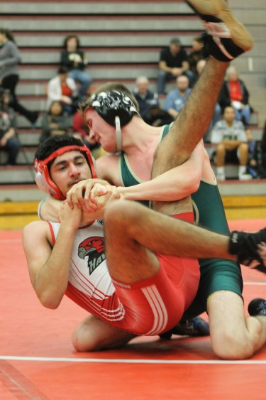 Mujtaba Abosabaa (left) gets wrapped up by Marysville-Getchell's Anthony LaBrake in the early match between the Chargers and Mountlake Terrace.