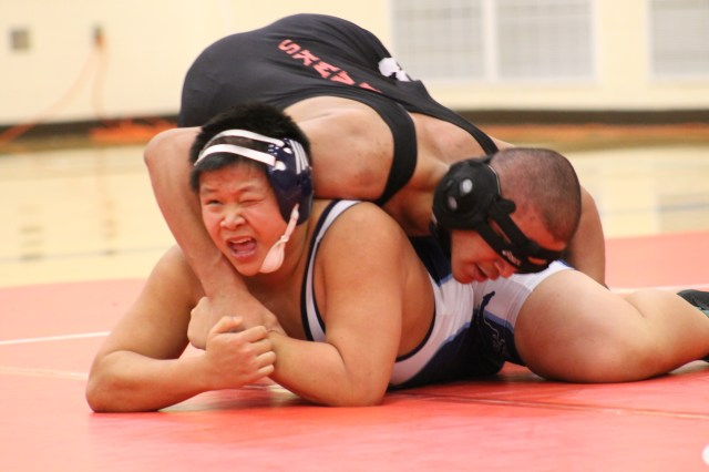 Meadowdale's Benjamin Duong looks to escape the grasp of Mountlake Terrace's Lex Davis in a 195-pound weight class match Tuesday at Lynnwood High School. Davis won the match 6-3. (Photos by Doug Petrowski)