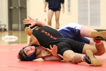 Meadowdale's Ryan Kennedy struggles in his 113-pound weight class match against Mountlake Terrace's Pedro Hernandez.