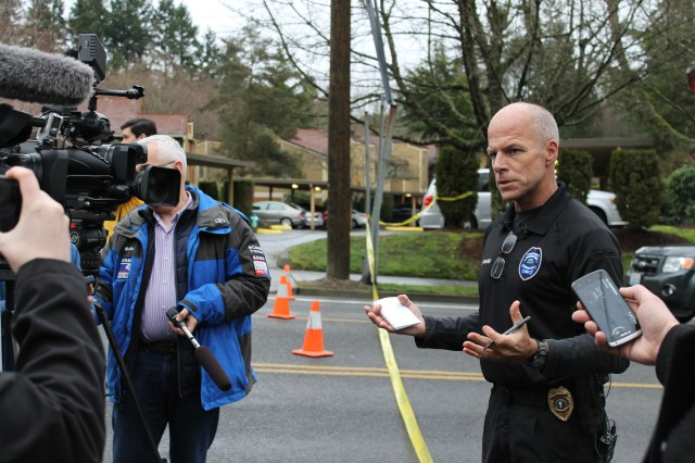 Mountlake Terrace Police Commander Kevin Pickard briefs the media near where the body was discovered Sunday.