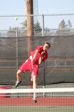 Terrace's Drake Day powers a serve in this singles match against the Mavericks' William Kim Monday at Mountlake Terrace High School.