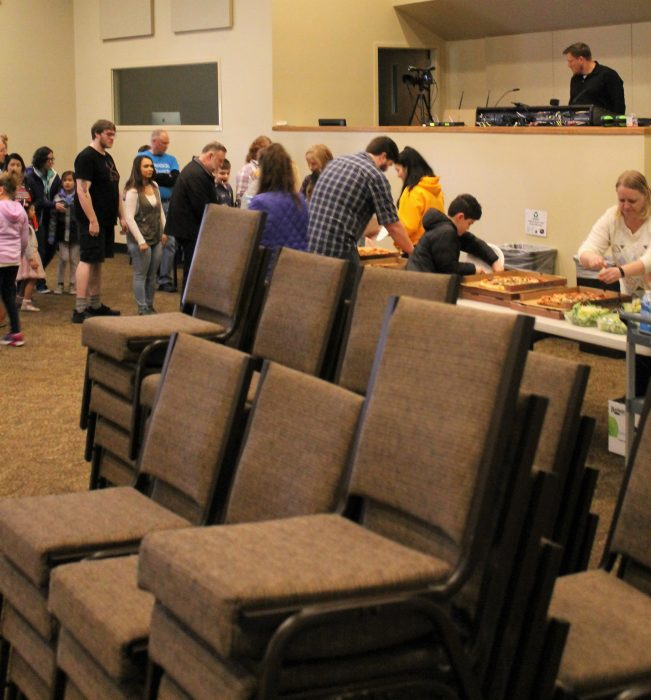 With Their Sanctuary Chairs Already Stacked And Ready For Moving,  Volunteers At Creekside Church In Mountlake Terrace Enjoy A Pizza Lunch On  Sunday Before ...