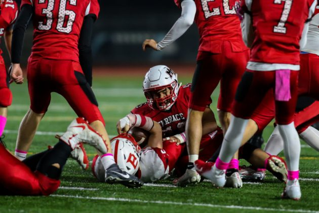 Arjae Guiao making a tackle on Bellingham's 4th down to get a turnover on downs