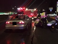 The scene of Tuesday night's car-pedestrian crash on Highway 99
