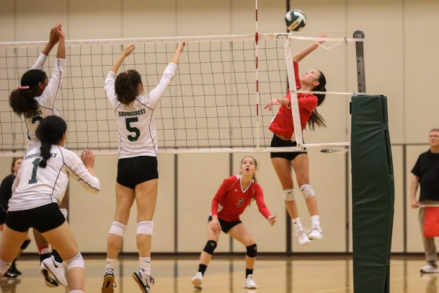 Kaylee Wagner with a kill down the line to avoid Shorecrest's Julia Nichols (left) and Amanda Lee (right)