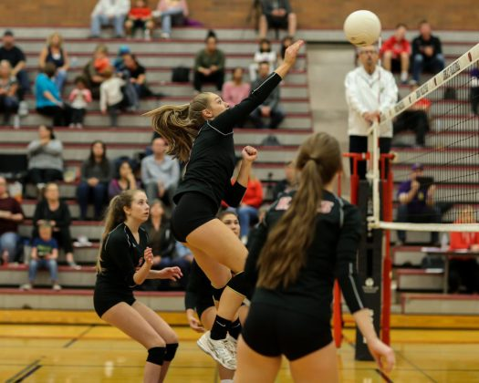 Mountlake Terrace's Kiana Hinckley (center) rises for a kill in the Hawks' match against the visiting Oak Harbor Wildcats Tuesday at Mountlake Terrace High School