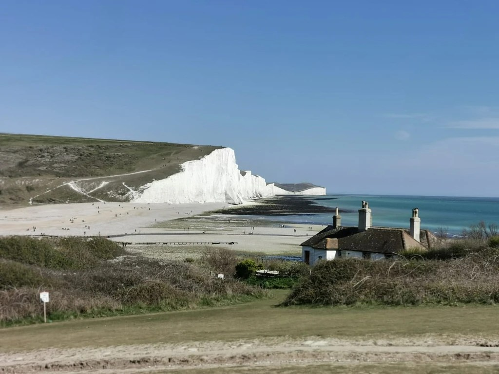 Coast Guard Cottages in the forground while the rolling Seven Sisters cliffs in the background
