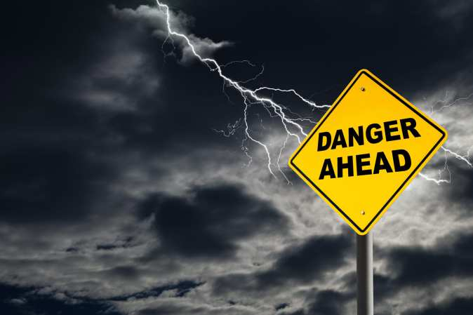 Danger Ahead Sign Against Cloudy and Thunderous Sky - Systems 4PT