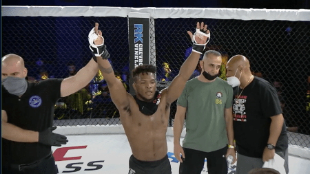 Solomon Renfro gets his right arm raised by a referee in the CFFC cage.