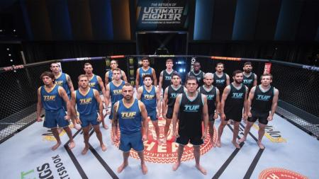 """The cast of """"The Ultimate Fighter"""" stands inside a UFC cage."""