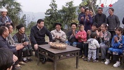 photo of President Xi Jinping with people in poor region