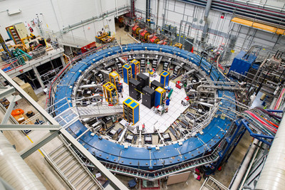 The Muon g-2 ring sits in its detector hall amidst electronics racks, the muon beamline, and other equipment. This impressive experiment operates at negative 450 degrees Fahrenheit and studies the precession (or wobble) of muons as they travel through the magnetic field.
