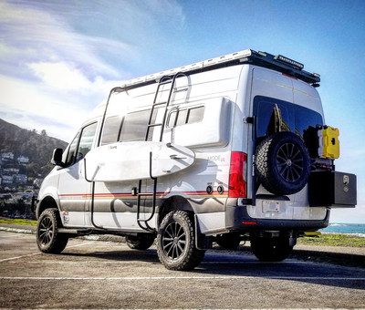 Storyteller Overland Beast MODE concept with surf rack, hinge mounted spare tire carrier, Sherpa Rack and rear locker box.