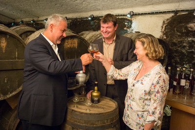 Hernan Parra (Dictator Rum Master Distiller), Mickaël Bouilly (Hardy Cognac Cellar Master), and Bénédicte Hardy (owner of Hardy Cognac) toasting the 2 Masters project.