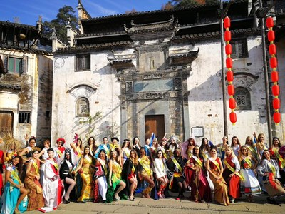 Miss Tourism Queen of the Year International Tour Lands in Chinese Village of Huangling.
