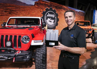 "Steve Beahm, Head of Parts & Service (Mopar) and Passenger Car Brands, FCA - North America, celebrates with the Specialty Equipment Market Association (SEMA) Show ""4x4/SUV of the Year"" award, captured by the Jeep® Wrangler for the ninth consecutive year."