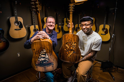 "Scott Sasser (left) of C.F. MARTIN & CO.® and Sailor Jerry Spiced Rum Ambassador, Daniel ""Gravy"" Thomas (right) showcase the Ink & Wood special edition guitar series."