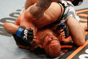 Frankie Edgar batters BJ Penn from the crucifix position.