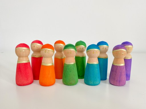 Peg people that have been dyed using liquid watercolour.