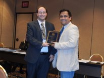 "Geoffrey Graybeal (Texas Tech University) presents the Second Place Student Paper Award to Dhiman Chattopadhyay (Bowling Green State University), for his paper, ""Why do Journalists Resist Change?"" #AEJMC16"