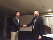 Joseph Yoo from The University of Texas at Austin receives his top student paper award from Axel Roepnack, Research Chair for the 2014-2015 paper competition.