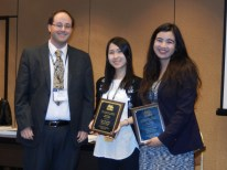 "Geoffrey Graybeal (Texas Tech University) presents the First Place Student Paper Award to Dam Hee Kim and Meera Desai (University of Michigan), for their paper, ""Why are News Media on Social Media? Explaining News Engagement on Tumblr and Digital Traffic to News Websites."" #AEJMC16"